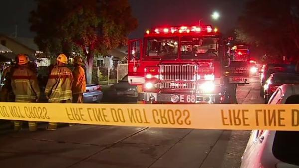 West Adams fire in converted garage injures 4
