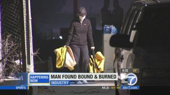 An investigation continues on Wednesday, April 16, 2014, after a man was found bound and burned on the 605 Freeway in Industry.
