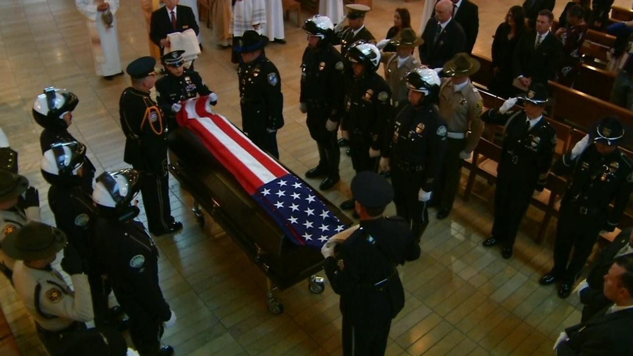 Uniformed officers carry Chris Cortijos casket into Cathedral of Our Lady of the Angels in Los Angeles on Tuesday, April 22, 2014.