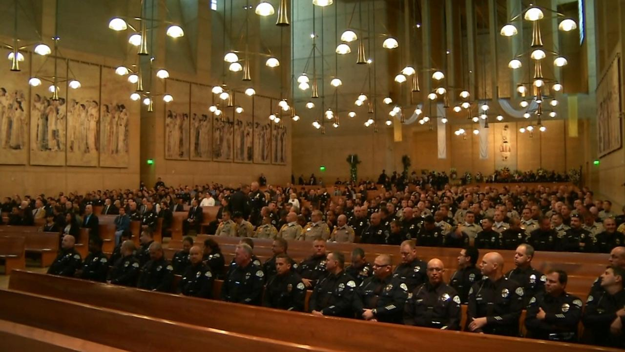 Attendees wait for the services for LAPD Officer Chris Cortijo to begin on Tuesday, April 22, 2014.
