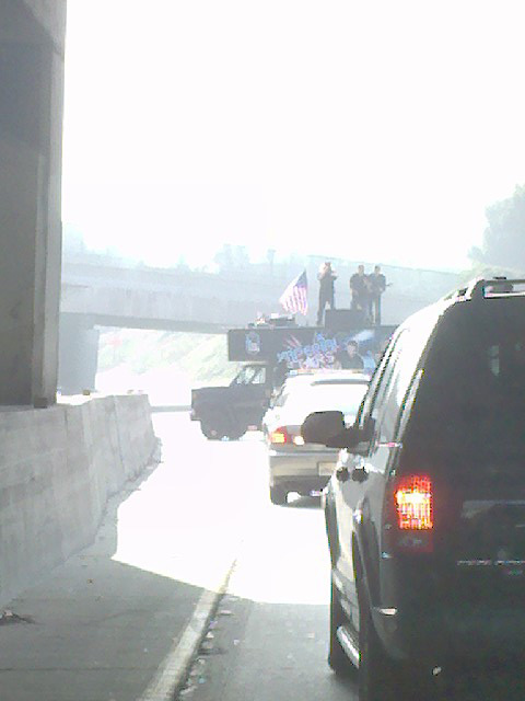 An ABC7 Eyewitness News viewer sent in a photo that shows men who appeared to be playing on top of a truck in the middle of the 101 Freeway on Tuesday, Oct. 12, 2010.