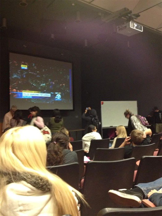 A classroom is seen watching ABC7 for information during a search for two possibly armed suspects on the California State University Fullerton campus on Wednesday, Dec. 12, 2012. <span class=meta>(pic.twitter.com&#47;mie5MXwl)</span>