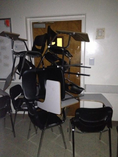 CSUF students barricaded the door to their class with desks during a search for two possibly armed suspects on campus on Wednesday, Dec. 12, 2012. <span class=meta>(pics.lockerz.com&#47;s&#47;268510987)</span>