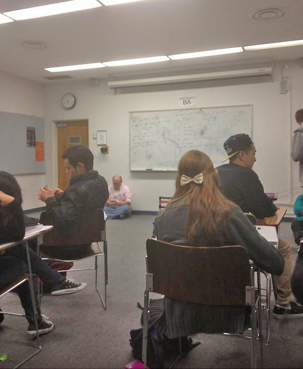 A classroom is seen waiting out a search for two possibly armed suspects on the California State University Fullerton campus on Wednesday, Dec. 12, 2012. <span class=meta>(twitter.com&#47;slimkid_j)</span>