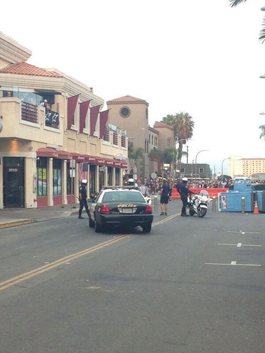 A police presence is seen during what police called a major disturbance in Huntington Beach following the U.S. Open of Surfing on Sunday, July 28, 2013. <span class=meta>(twitter.com&#47;@franK_KrasiL)</span>