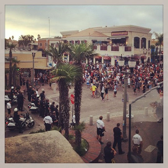Crowds act unruly during what police called a major disturbance in Huntington Beach following the U.S. Open of Surfing on Sunday, July 28, 2013. <span class=meta>(heatherangel7 on Instagram)</span>