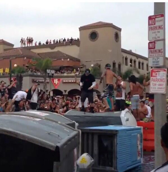 "<div class=""meta ""><span class=""caption-text "">Crowds act unruly during what police called a major disturbance in Huntington Beach following the U.S. Open of Surfing on Sunday, July 28, 2013. (twitter.com/@AyyRayRay222)</span></div>"