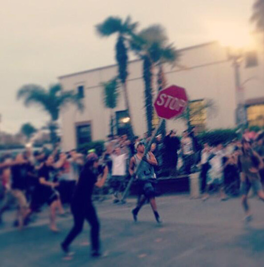 Crowds act unruly during what police called a major disturbance in Huntington Beach following the U.S. Open of Surfing on Sunday, July 28, 2013. <span class=meta>(twitter.com&#47;@AyyRayRay222)</span>