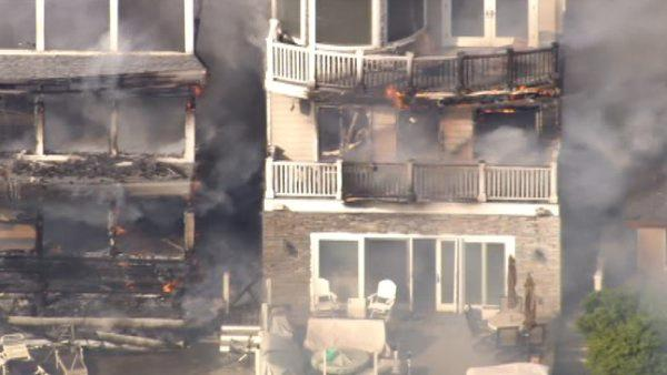 A four-alarm fire damaged three beachfront homes in Sunset Beach, one of which collapsed, on Thursday, May 12, 2011.