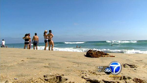 Beachgoers in Newport Beach look out to the ocea