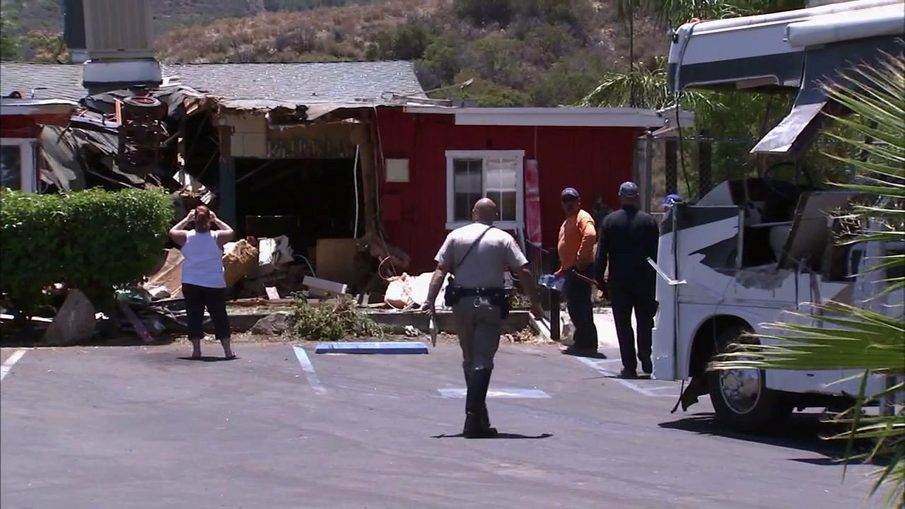Police are seen at Lazy Js Roadhouse in Lake Elsinore following an RV crash that left the driver dead on Thursday, June 21, 2012.
