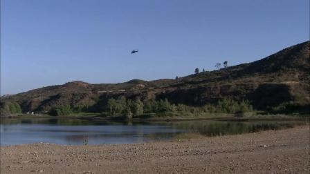 A helicopter flies over Irvine Lake, where two men went missing after their inflatable boat capsized on Sunday, June 24, 2012.