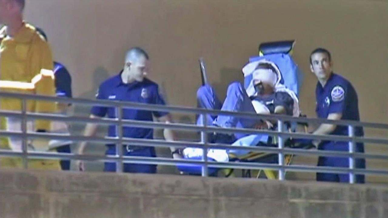 A man is taken into treatment after being injured from illegal fireworks in Huntington Beach on Wednesday, July 4, 2012.