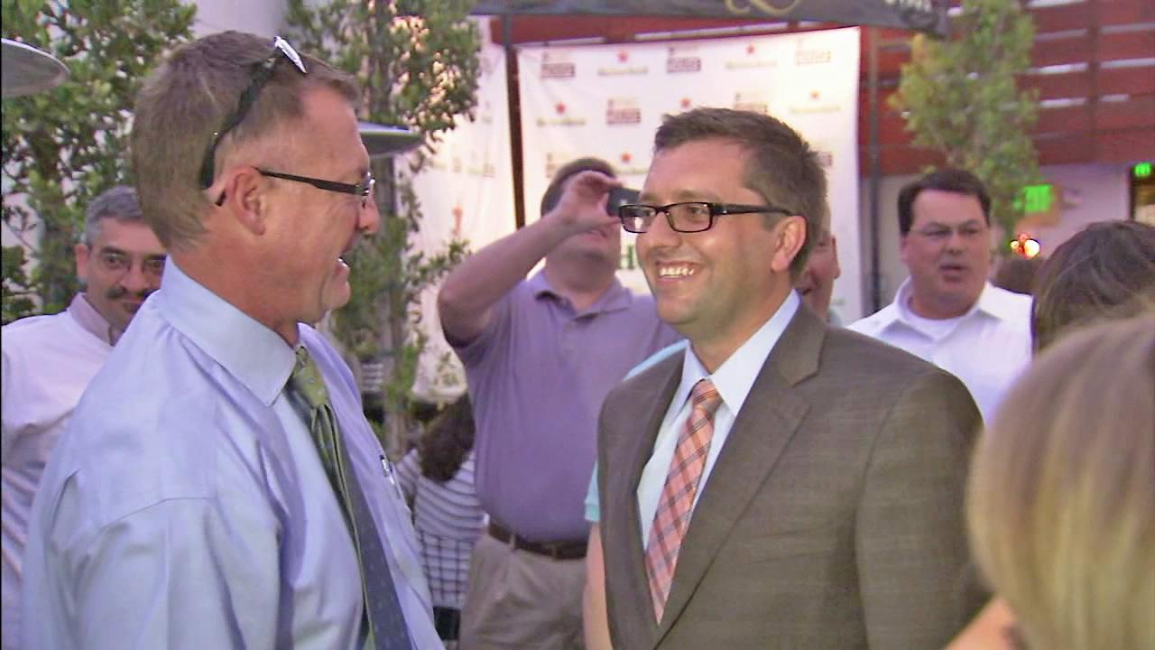 New Fullerton City Councilman Travis Kiger (right) is seen in this file photo.