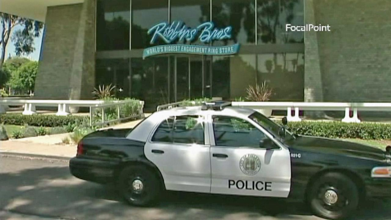 A Fullerton police vehicle is shown outside of a Robbins Brothers in Fullerton, which was broken into on Saturday, July 28, 2012.