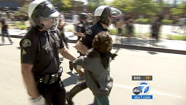 Police arrest a man during a protest in Anaheim on Sunday, July 29, 2012, over the fatal police shootings of two men.