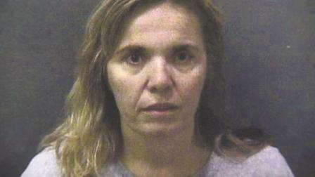 Kathia Davis, 45, is shown in this booking photo.