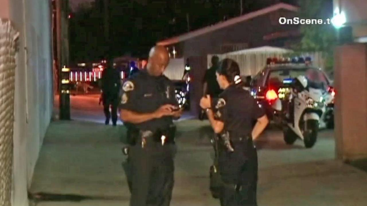 Investigators are shown at the scene of a deadly stabbing in Anaheim on Thursday, Aug. 30, 2012.