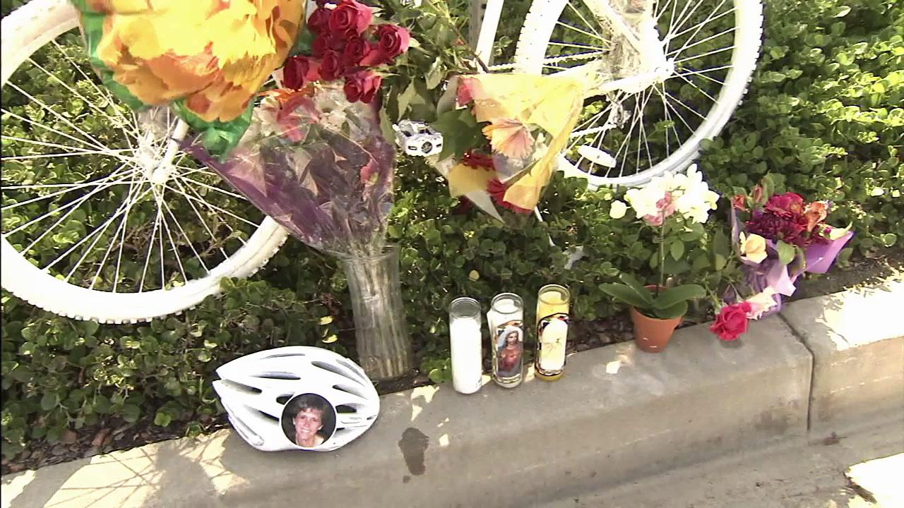 A memorial is seen where a  57-year-old woman was fatally struck by a pickup truck while riding her bicycle in Newport Beach on Saturday, Sept. 15, 2012.