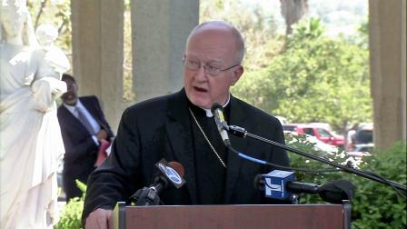 Bishop Kevin Vann is speaking to a crowd in this undated file photo.