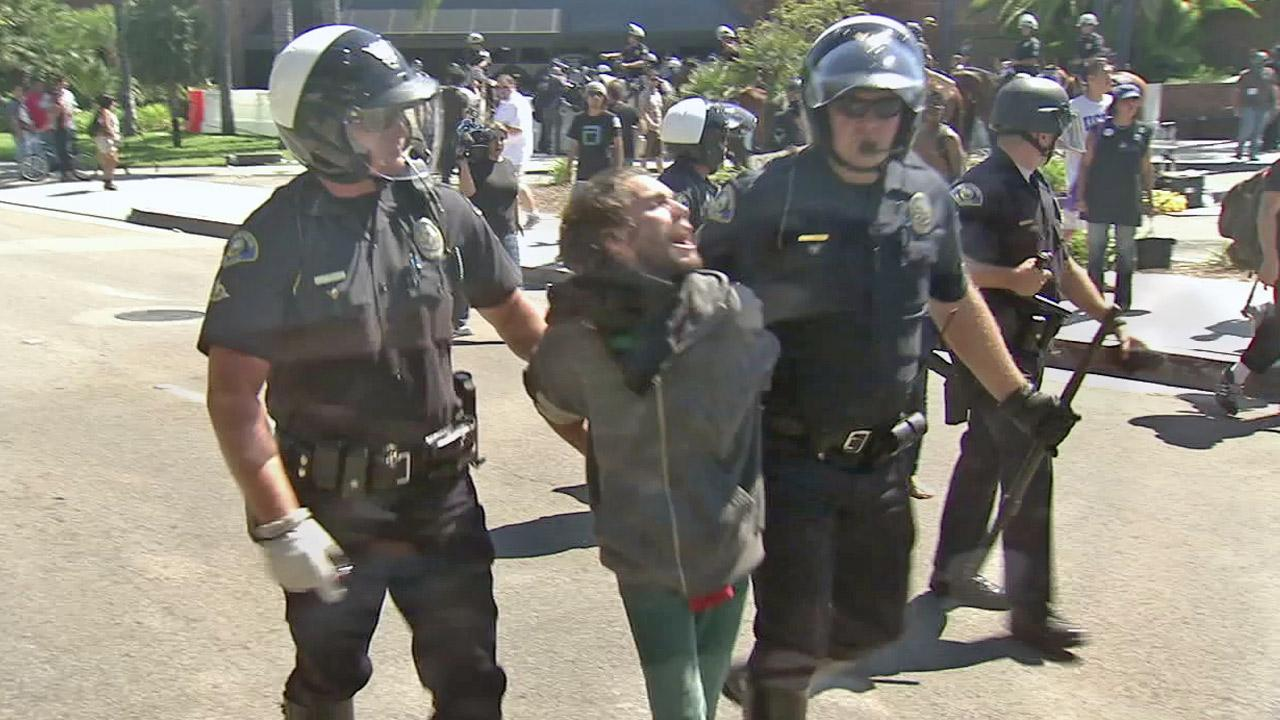 Anaheim police officers detain a man in this undated file photo.