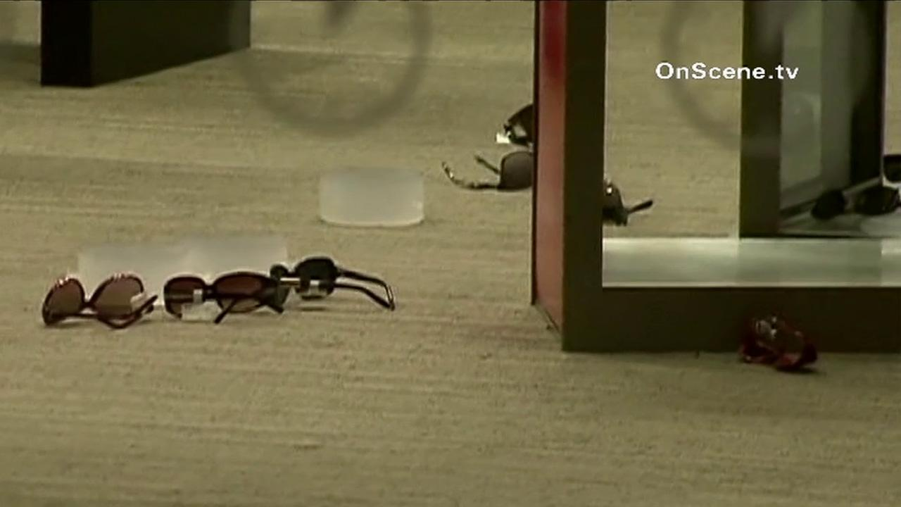 Sunglasses are seen on the floor at a LensCrafters store in Irvine after a burglary on Wednesday, Oct. 3, 2012.