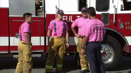 Fullerton firefighters wear pink to raise awareness for breast cancer and cancer research.