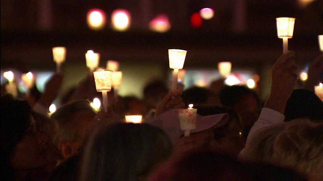 Many gathered on Thursday, Oct. 11, 2012, for a vigil to remember the first anniversary of a deadly salon shooting in Seal Beach.