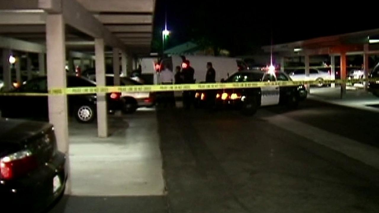 Authorities investigate at an apartment complex in La Palma, where a mans body was found inside a car on Wednesday, Oct. 24, 2012.