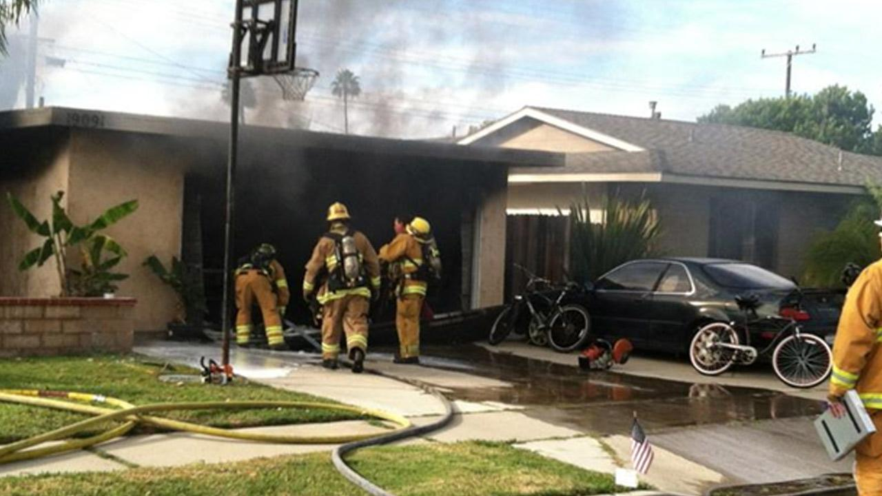 Firefighters at the scene of a house fire on the 19000 block of Woodward Lane in Huntington Beach.
