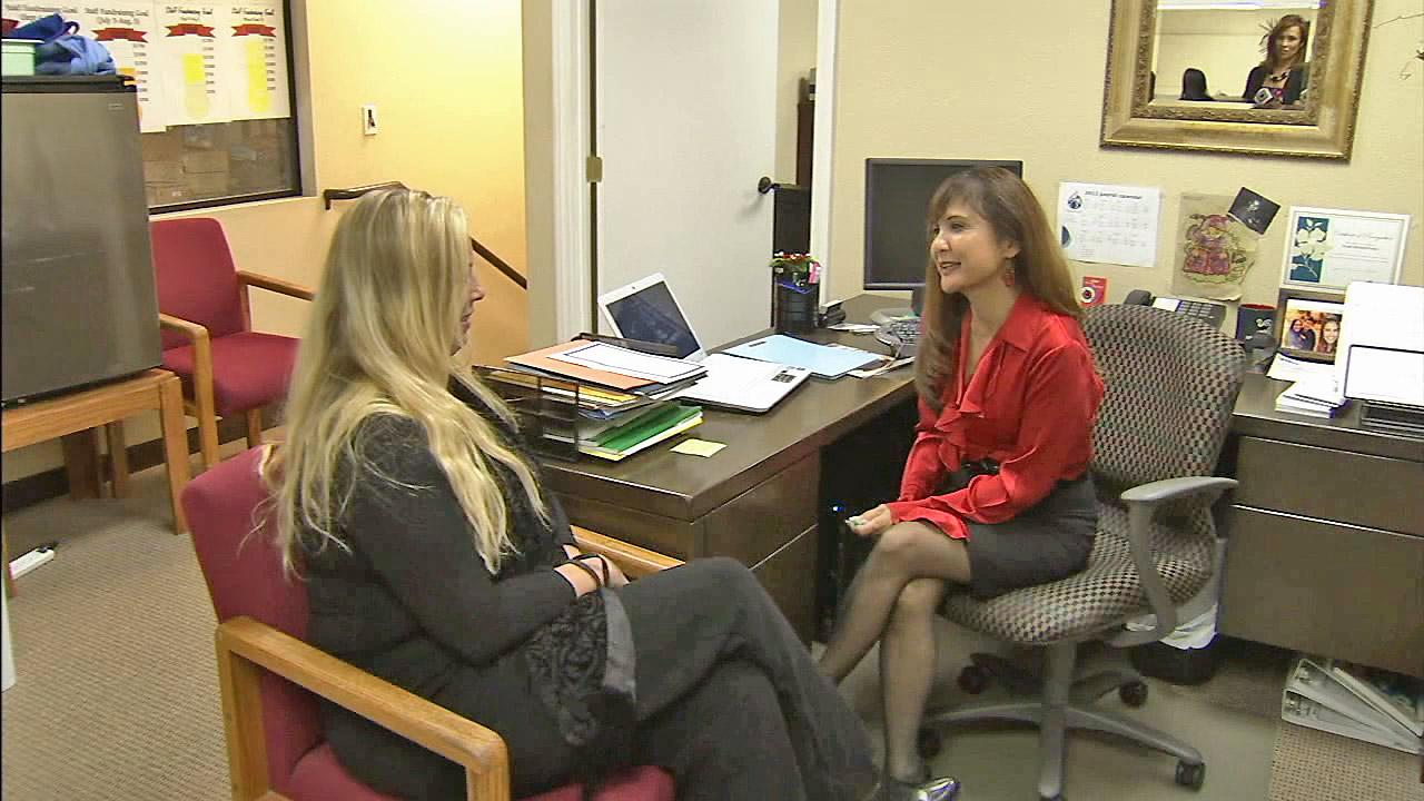 Lorri Galloway (right), executive director of the Eli Home is seen talking with former resident Danielle Moser (left) in this undated file photo.
