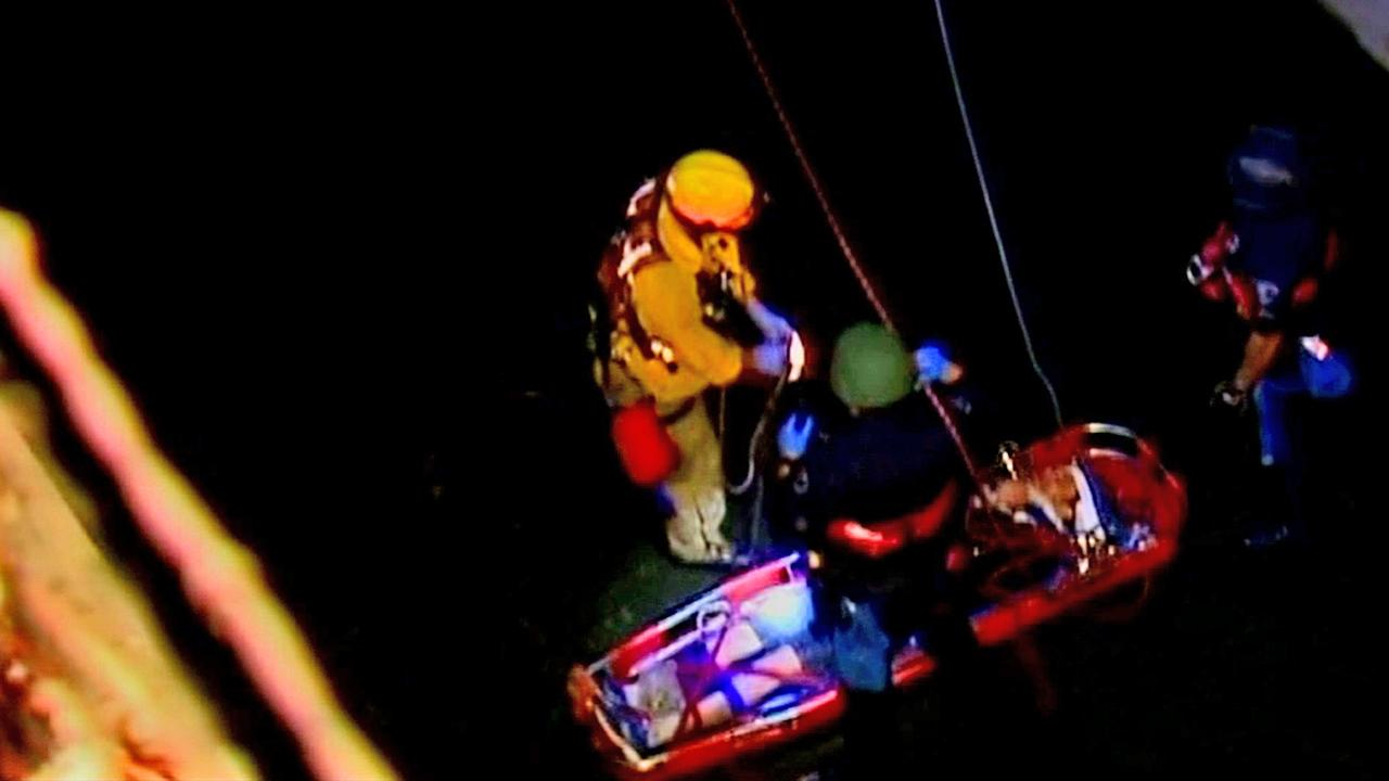 A suspected car thief was pulled to safety after jumping into a flood control channel in La Mirada on Thursday, Nov. 29, 2012.
