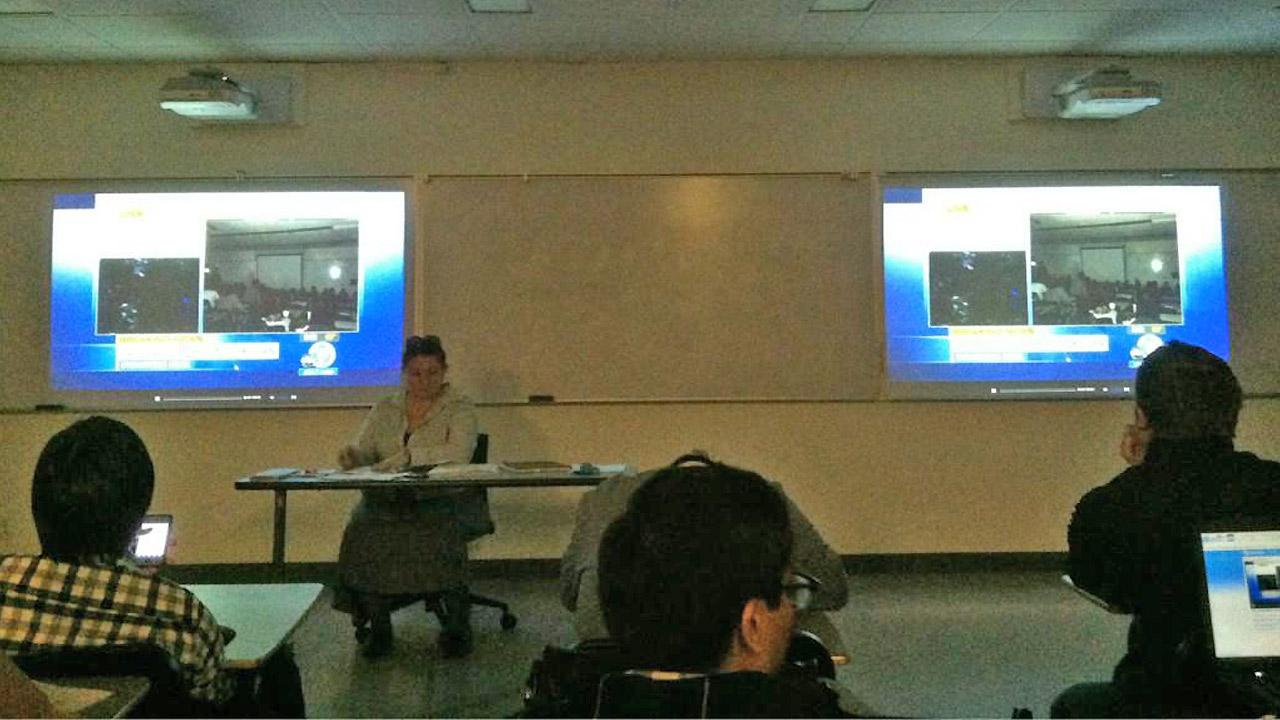 A classroom is seen watching ABC7 for information during a search for two possibly armed suspects on the California State University Fullerton campus on Wednesday, Dec. 12, 2012.twitter.com/stephengodoy