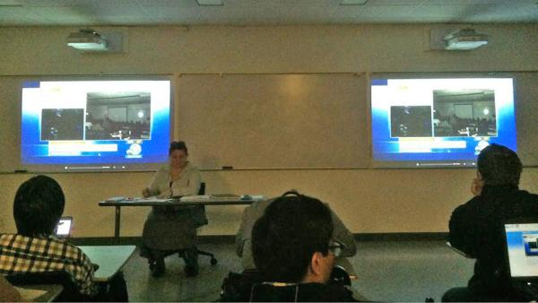 A classroom is seen watching ABC7 for information during a search for two possibly armed suspects on the California State University Fullerton campus on Wednesday, Dec. 12, 2012.
