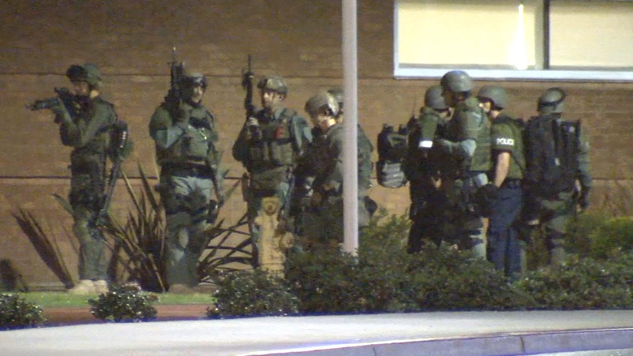 Authorities move in on a building on the California State University, Fullerton, campus where they believed a possibly armed suspect may have been hiding out on Wednesday, Dec. 12, 2012.