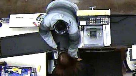Deputies released surveillance camera photos of an armed  man who robbed a Ralphs grocery store in San Clemente Tuesday, Dec. 18, 2012.