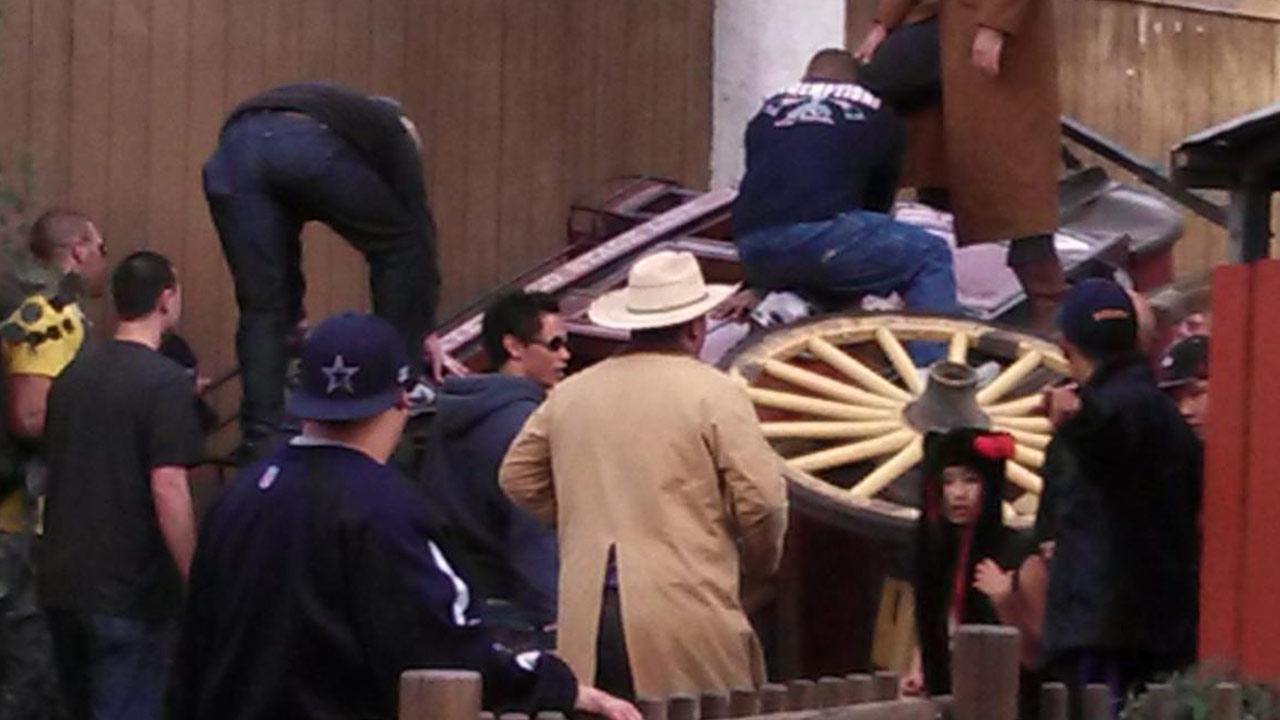 Three Knotts Berry Farm visitors sustained minor injuries Sunday, Dec. 30, 2012, when a stagecoach they were riding in tipped over after one of its wheels detached.