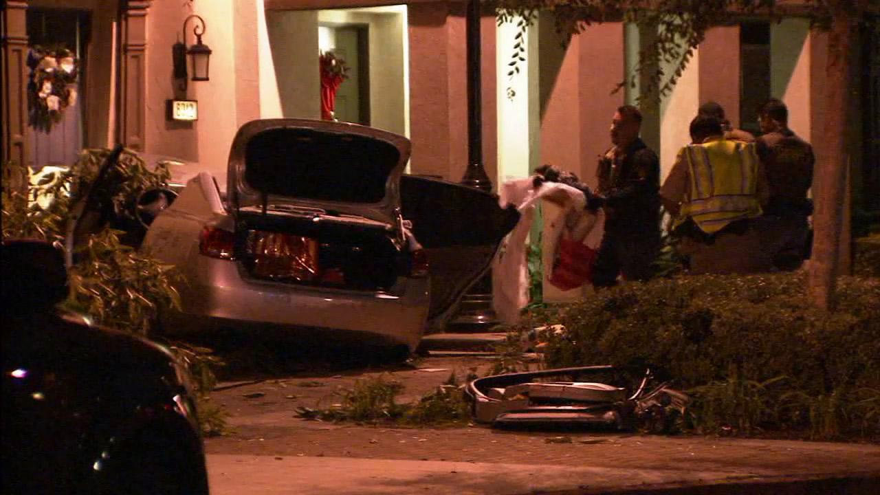 A brief pursuit ended with a car crashing into a townhouse in Stanton on Wednesday, Jan. 23, 2013.