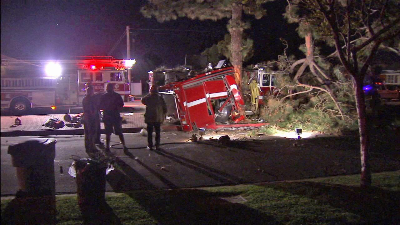 Investigators at the scene of a crash involving a fire truck in Buena Park on Wednesday, March 14, 2013.