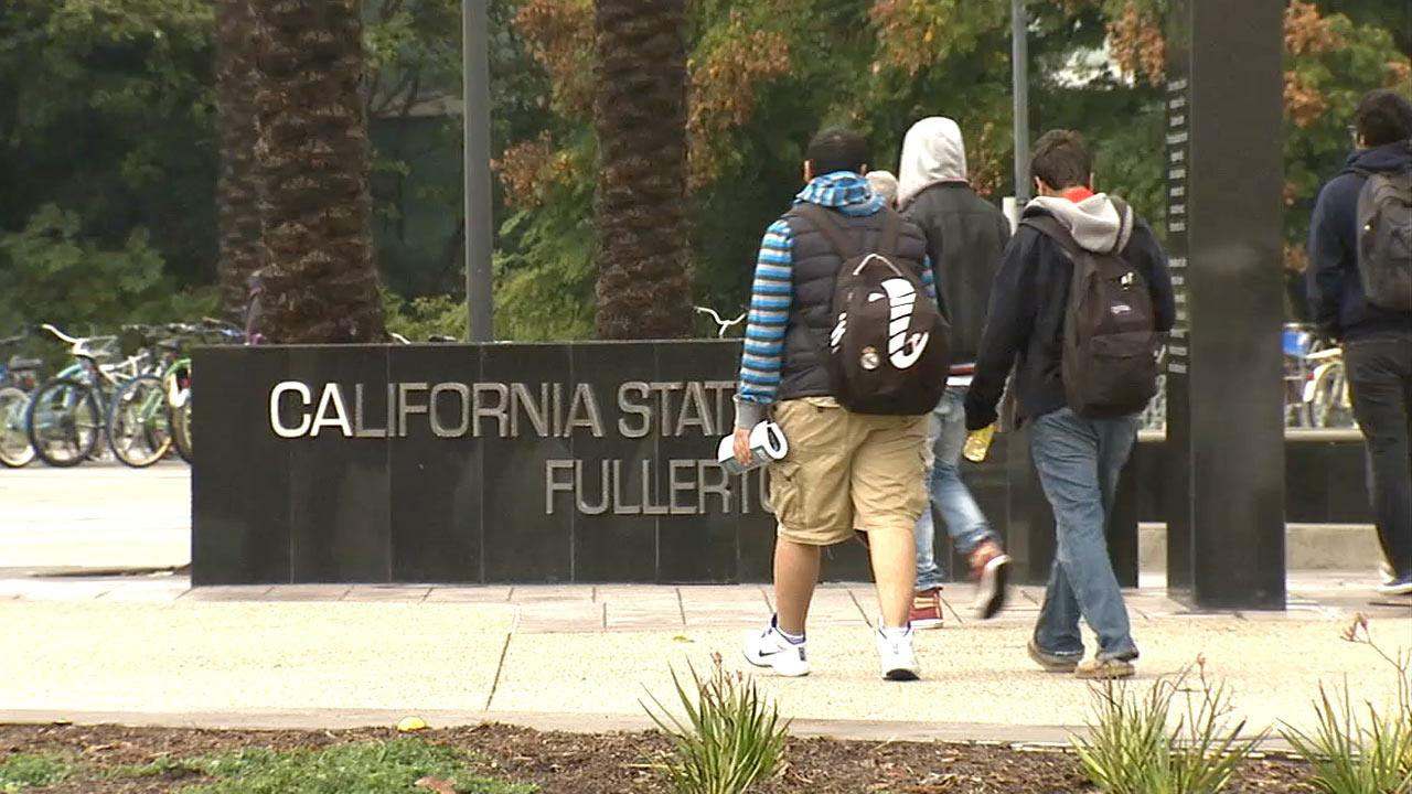 Students walk on the California State University, Fullerton, campus Tuesday, March 19, 2013.