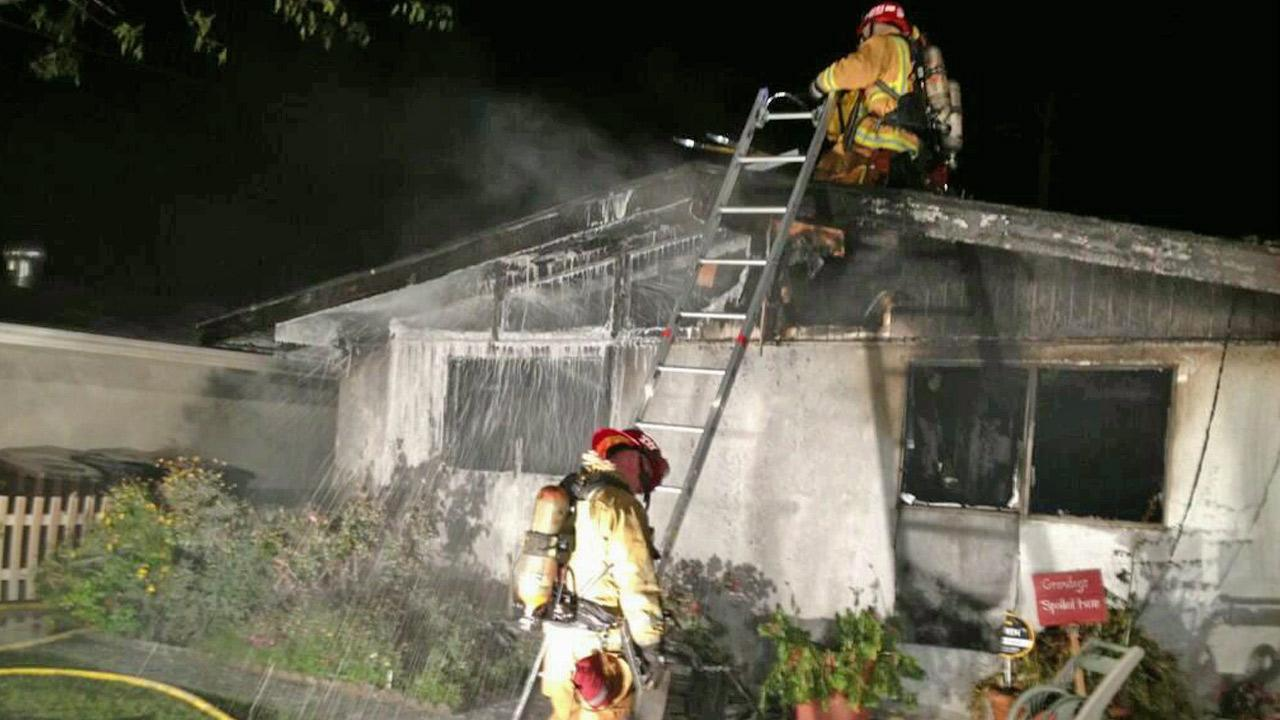 Firefighters battle a house fire near Stanton in Orange County in this April 2013 photo.