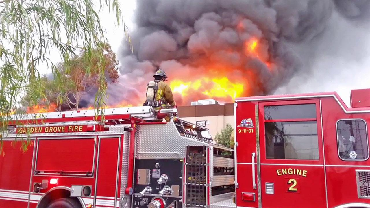 Firefighters battle a fire that damaged two businesses on the 11000 block of Western Avenue in Garden Grove on Saturday, April 13, 2013.