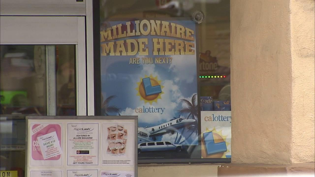 A California Lottery sign is seen at a CVS store in Orange County, where a woman won $14 million.