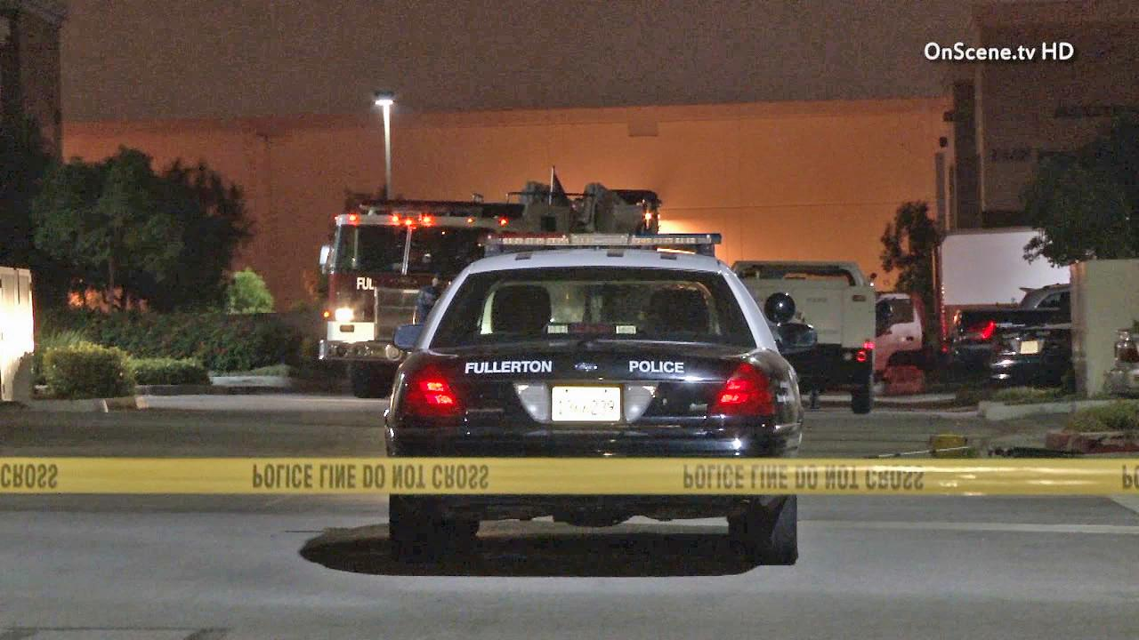 Fullerton police are seen at a clothing manufacturer in the 1400 block of East Valencia Drive on Wednesday, June 12, 2013, after reports of a man assaulting his boss. Police shot and killed the man after he returned to the scene with a gun.