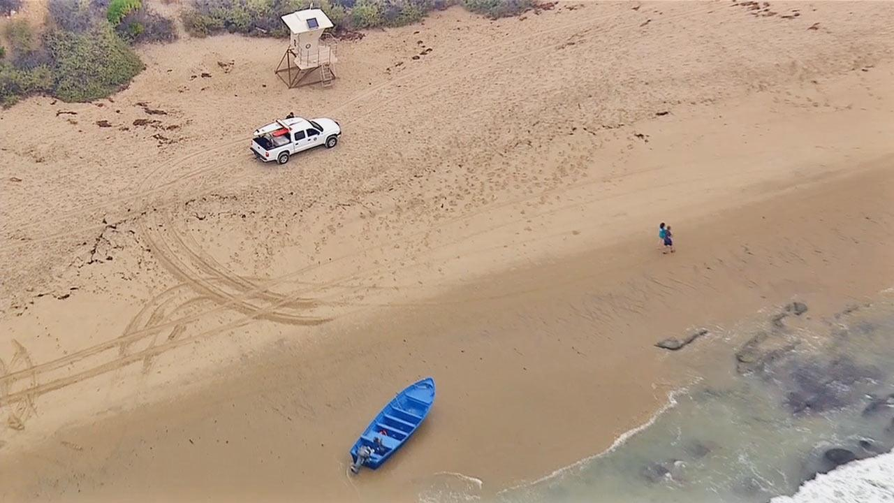 Twenty-four people were arrested when a panga boat was spotted near Crystal Cove State Park in Orange County Thursday morning, June 13, 2013.