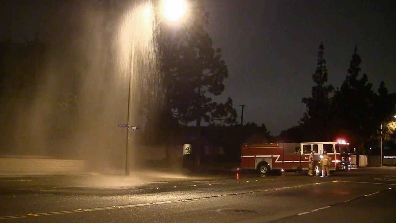 Water is seen soaring into the air after a vehicle crashed into a fire hydrant at Sunkist Street and Puritan Drive in Anaheim on Saturday, July 13, 2013.