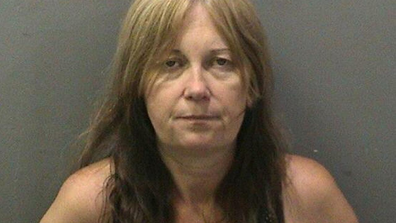 Rebecca McLaughlin, 48, was arrested on suspicion of intentionally hitting an Orange County sheriffs special officer on bike patrol at John Wayne Airport on Tuesday, July 16, 2013.