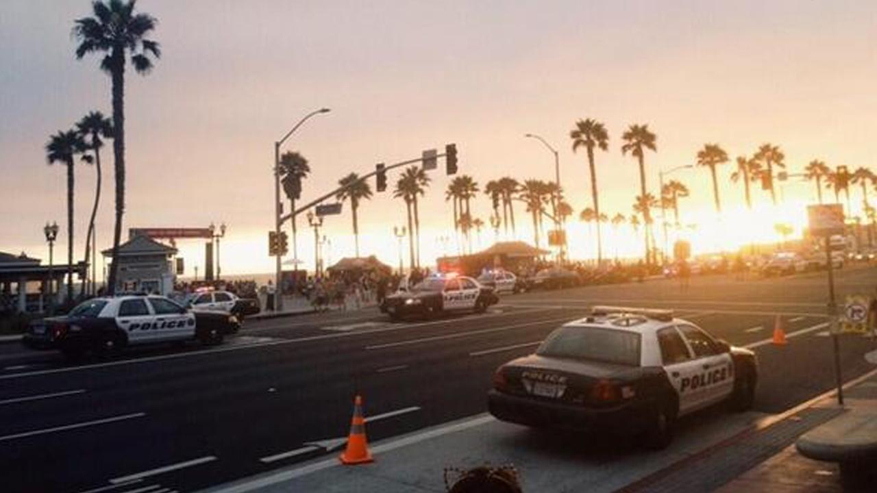 A heavy police presence is seen during what police called a major disturbance in Huntington Beach following the U.S. Open of Surfing on Sunday, July 28, 2013. <span class=meta>(twitter.com&#47;@1none)</span>