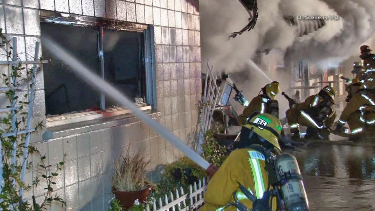Firefighters battle a structure fire in the 700 block of Main Street in the city of Orange on Wednesday, Sept. 18, 2013.