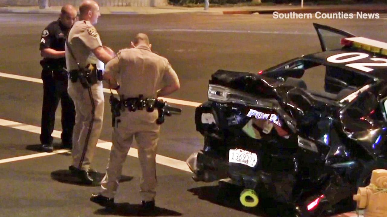 Law enforcement officers gather near the scene of a car crash involving an officer with the Buena Park Police Department on Friday, Oct. 11, 2013.